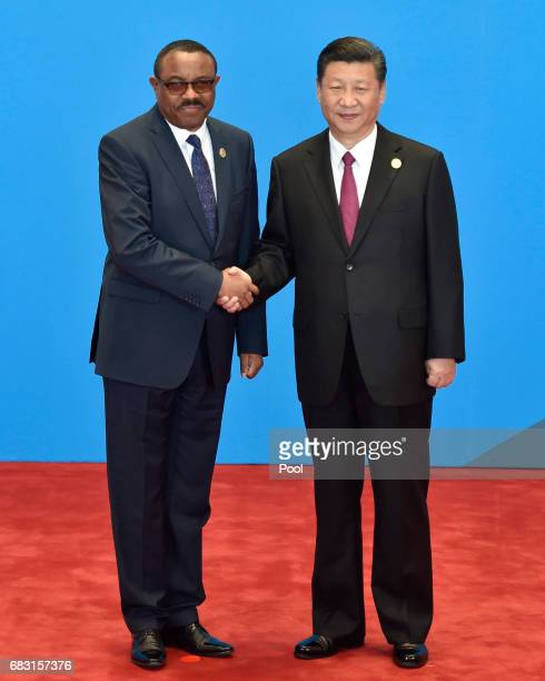 Ethiopia's Prime Minister Hailemariam Desalegn shakes hands with Chinese President Xi Jinping during the welcome ceremony for the Belt and Road Forum...