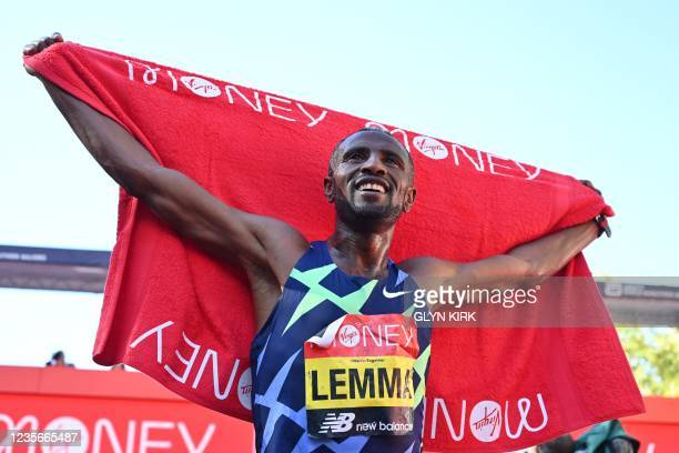 Ethiopia's Sisay Lemma celebrates after he wins the elite men's race of the 2021 London Marathon in central London on October 3, 2021. - - Restricted...