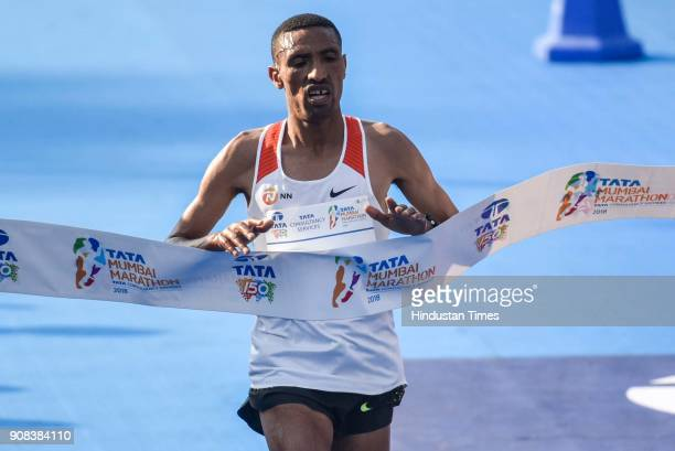 Ethiopia's Solomon Deksisa prepares to cross the finish line to win the men's category of Tata Mumbai Marathon 2018 at CSMT on January 21 2018 in...