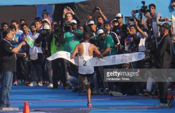 Ethiopia's Solomon Deksisa who won the Mumbai Marathon at the finishing line on January 21 2018 in Mumbai India