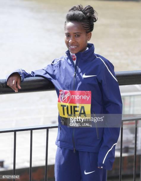 Ethiopia's Tigist Tufa poses outside Tower Bridge in central London during a photocall for the Women's marathon elite athletes on April 19, 2017...