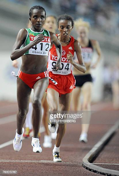 Ethiopia's Tirunesh Dibaba competes ahead of Turkey's Elvan Abeylegesse during the womens 10000m 25 August 2007 at the 11th IAAF World Athletics...