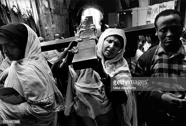 Ethipian pilgrims carry a cross down the Via Dolorosa during the Easter celebrations The Ethiopian Orthodox Monastery built on the roof of the Holy...