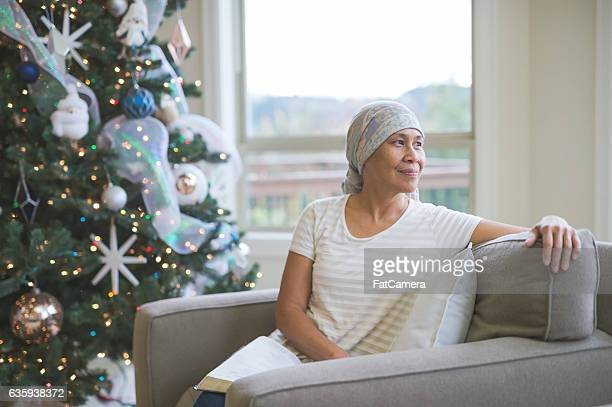 Ethnic adult female cancer patient reflecting and