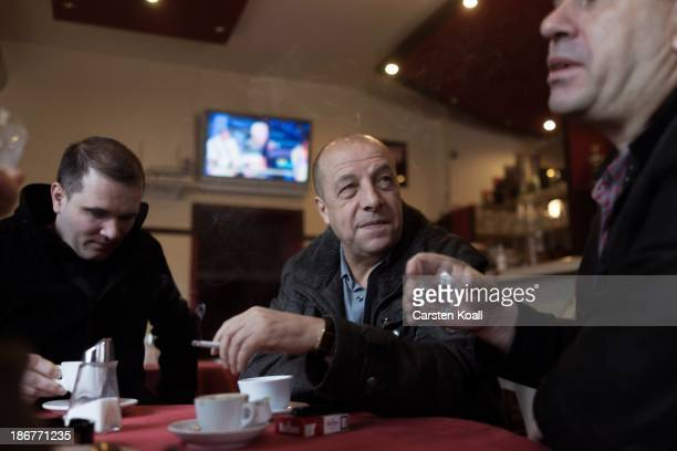 Ethnic Albanian men Nuhi Kaili and Mustafer Iseni sit with Albanian friends in an Albanian pub Radush at Sonnenallee in Neukoelln district on...
