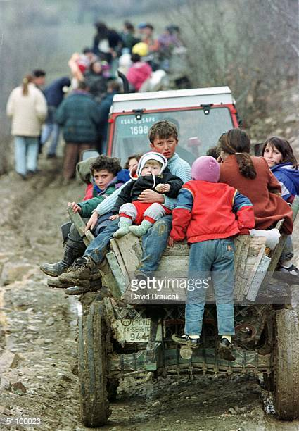 Ethnic Albanian Refugees From Marina Ride Tractors Down A Rugged Mountain Track As They Escape Fighitng Between The Yugoslav Army And The Kosovo...