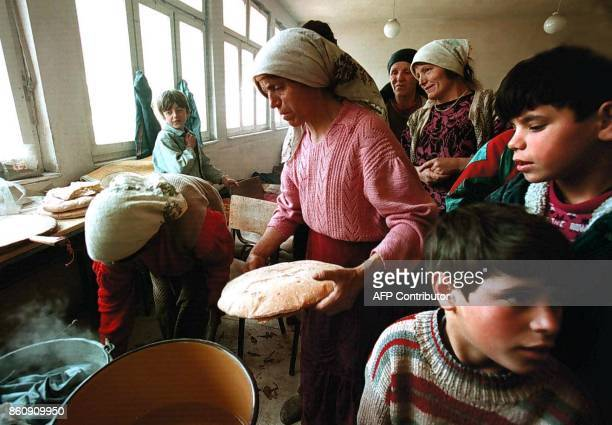 Ethnic Albanian women from the neighboring villages make bread in a school building in the village of Tusila 50km from Pristina 29 March About 300...