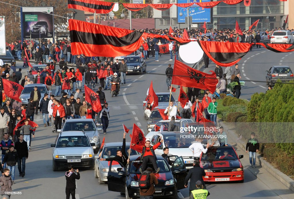 Ethnic Albanians drive in cars and wave flags on the streets of Skopje on November 25, 2012. Albanians from Macedonia today in Skopje celebrate 100 years of the Albanian flag and the Albanian Declaration of independence. ATANASOVSKI