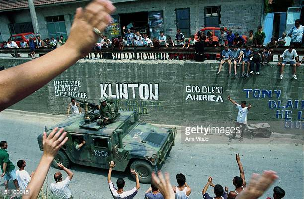 Ethnic Albanians Greet American Nato Troops As They Pass Through The Town Of Gnjilane June 30 1999 In Kosovo