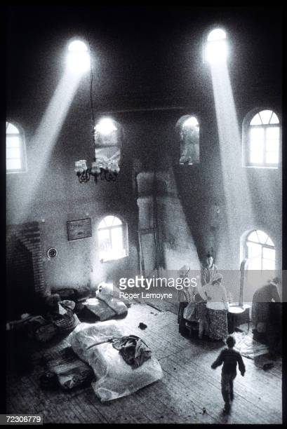 Ethnic Albanians use a mosque as a shelter in Chirez October 1998 in Kosovo Yugoslavia Many Albanians have fled Kosovo as a result of the fight for...