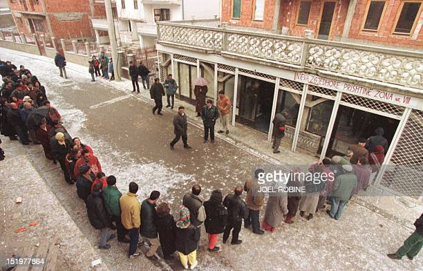 Ethnic Albanians wait in line 22 March before casting their ballots in Pristina in underground elections aimed at sending a defiant message to the...
