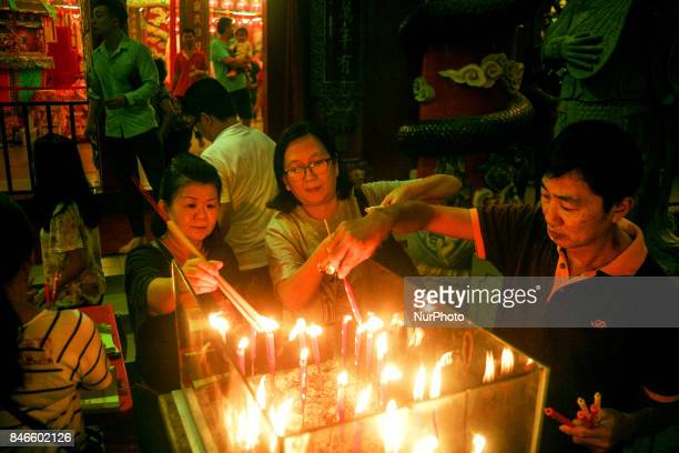 Ethnic Chinese burn a joss stick before start perform a special prayer inside the snake temple during Hungry Ghost Festivals in Teluk Pulai Klang,...