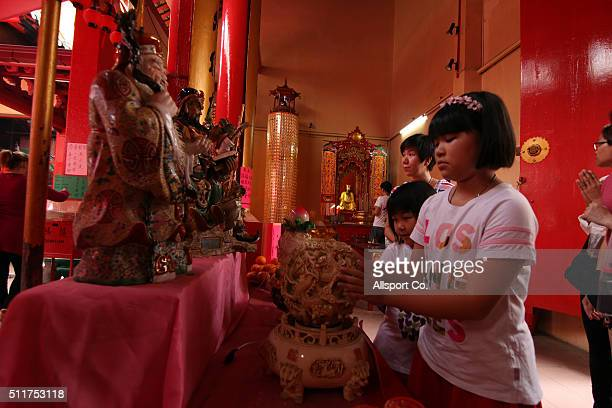 Ethnic Chinese children offer prayers at a temple prior to celebrate the Lantern Festival on the last day of Chinese Lunar New Year celebrations The...