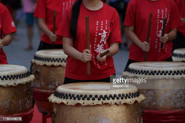 Ethnic Chinese girls and boys play the drums during a Chinese New Year day of 13th celebration at the Tin Hong Si temple in Kajang on February 17...