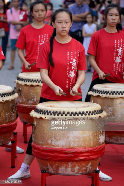 Ethnic Chinese girls play the drums during a Chinese New Year day of 13th celebration at the Tin Hong Si temple in Kajang on February 17 2019 in...