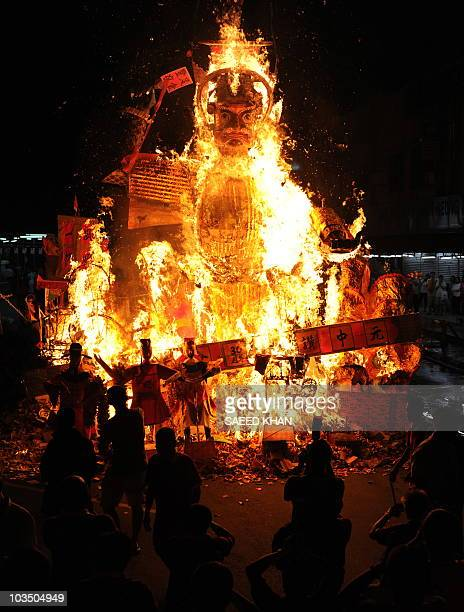 Ethnic Chinese in Malaysia burn a giant statue of the Chinese deity Da Shi Ye or Guardian God of Ghosts during the Hungry Ghost festival in Kuala...
