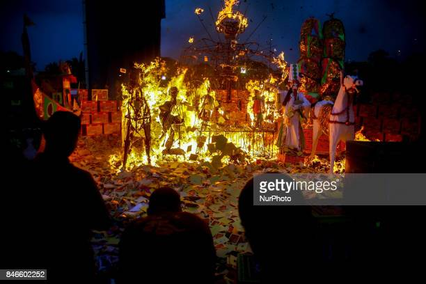 Ethnic Chinese in Malaysia throw a paper offerings a special prayer in front of God of Ghosts paper statue during the Hungry Ghost Festival in Teluk...