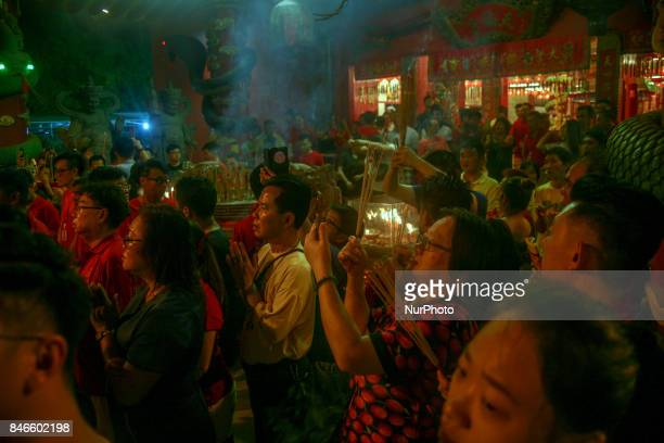 Ethnic Chinese perform a special prayer during the Hungry Ghost Festival in Teluk Pulai Klang, Malaysia on September 12, 2017.