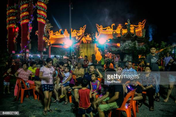 Ethnic Chinese watch a dance show during the Hungry Ghost Festival in Teluk Pulai Klang, Malaysia on September 12, 2017. Photo by Samsul Said