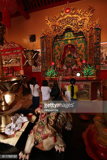 Ethnic Chinese women offer prayers at a temple prior to celebrate the Lantern Festival on the last day of Chinese Lunar New Year celebrations The...