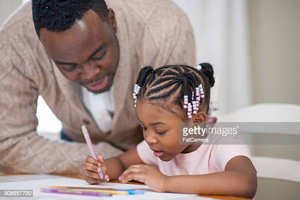 Ethnic Father Helping Her Daughter Learn Art