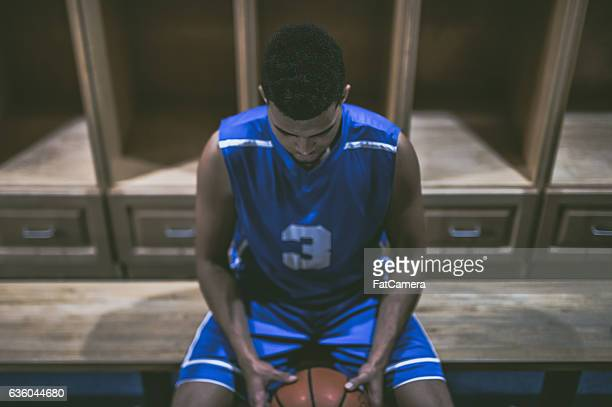 Ethnic high school basketball player mentally preparing for game