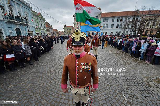 Ethnic Hungarian wear huszar outfits during a parade on Hungary's National Day in Targu Secuiesc on March 15 2013 Thousands of ethnic Hungarians from...