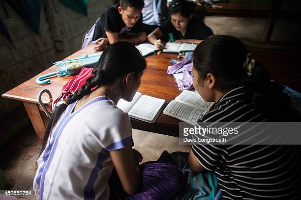 Ethnic Karen Christian refugees from Myanmar listen to a sermon at a border refugee camp Currently there are around 100000 refugees living in...
