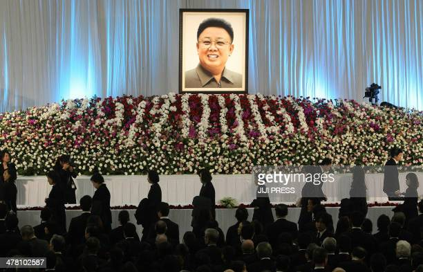 Ethnic Koreans in Japan offer flowers on the altar for the late North Korean leader Kim JongIl during a memorial service at a Korean cultural centre...