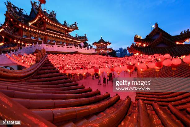 Ethnic MalaysianChinese devotees arrive to offer prayers at the Thean Hou temple decorated with red lanterns in Kuala Lumpur on February 15 2018 on...