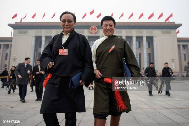 Ethnic minority delagate leaves the Great Hall of the People after the opening session of the Chinese People's Political Consultative Conference on...