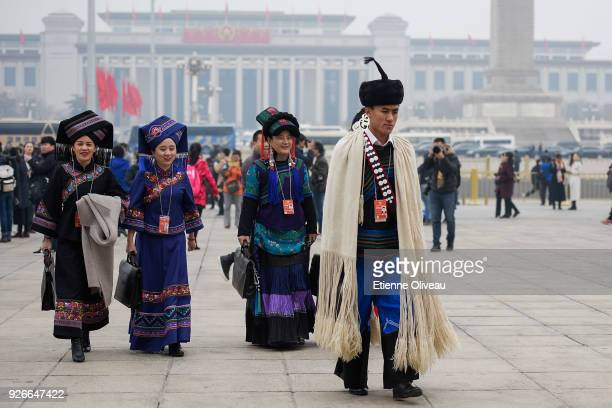 Ethnic minority delagates arrive at the Great Hall of the People before the opening session of the Chinese People's Political Consultative Conference...