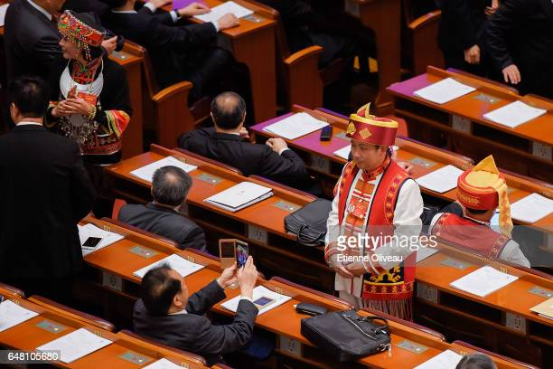 Ethnic minority delegate poses for a picture before the opening session of the National People's Congress at the Great Hall of the People on March 5...