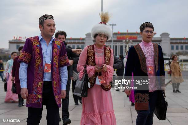 Ethnic minority delegates attend the opening session of the National People's Congress at the Great Hall of the People on March 5 2017 in Beijing...