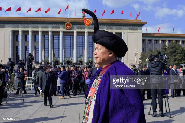 Ethnic minority delegates exit the Great Hall of the People after the opening session of the National People's Congress on March 5 2017 in Beijing...