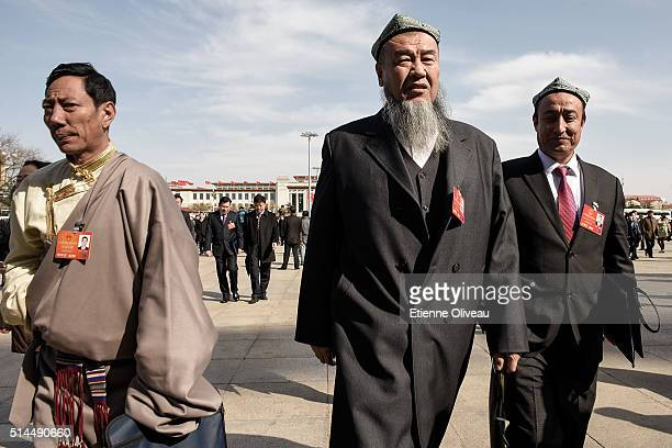 Ethnic minority delegates from Tibet and Xinjiang arrive at the Second plenary session of the National People's Congress on March 9, 2016 in Beijing,...