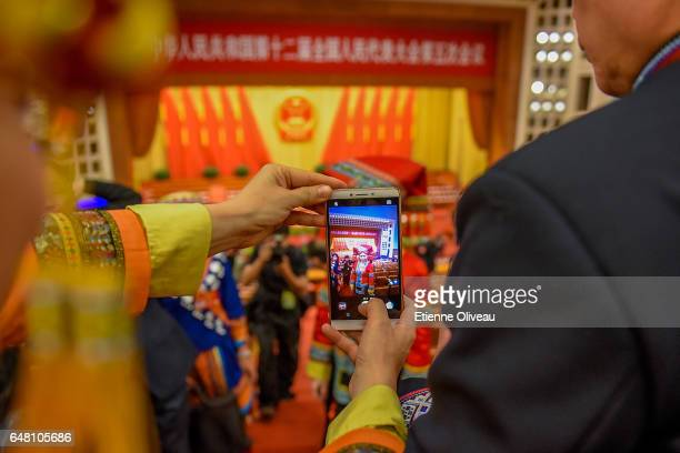 Ethnic minority delegates pose for a picture before the opening session of the National People's Congress at the Great Hall of the People on March 5...