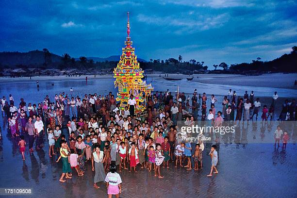 Ethnic Mon villagers participate to a Buddhist ceremony where a wooden miniature pagoda is sent away to the sea..
