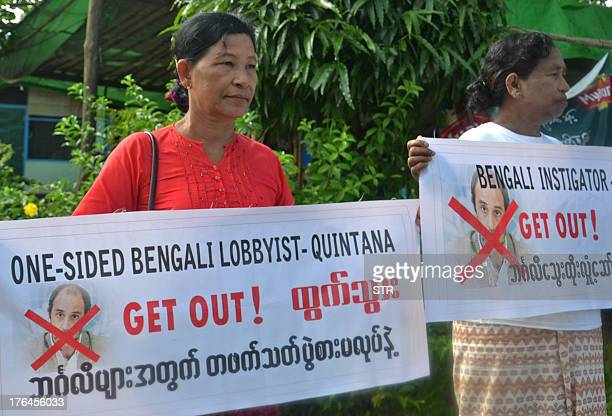 Ethnic Rakhine buddhist villagers hold placards as they demonstration during the visit of UN Human Right Rapporteur on Rights in Myanmar Tomas Ojea...