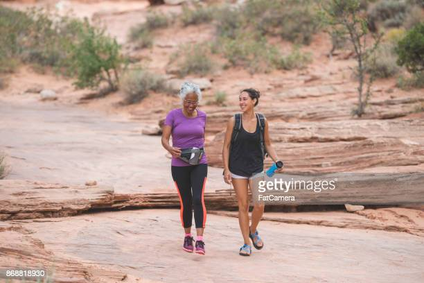 ethnic senior woman hiking with her adult daughter - povo havaiano imagens e fotografias de stock