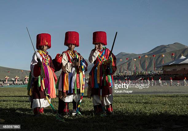 Ethnic Tibetan nomads wear tradtional costume on July 24 2015 at a local government sponsored festival on the Tibetan Plateau in Yushu County Qinghai...