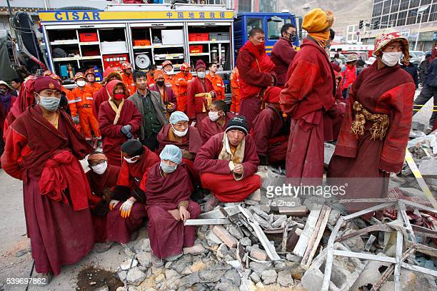 Ethnic Tibetans and monks rest while search for survivors in the earthquake-hit town of Gyegu in Yushu County, Qinghai Province April 17, 2010. VCP