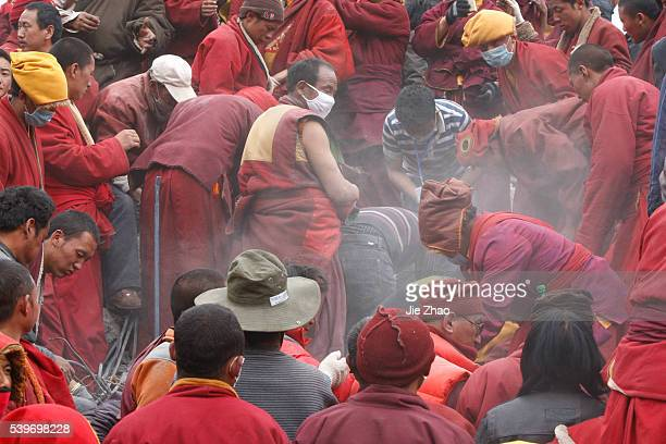 Ethnic Tibetans and monks search for survivors in the earthquake-hit town of Gyegu in Yushu County, Qinghai Province April 17, 2010. VCP