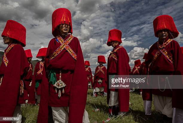 Ethnic Tibetans in traditional dress wait to perform on July 25 2015 at a local government sponsored festival on the Tibetan Plateau in Yushu County...