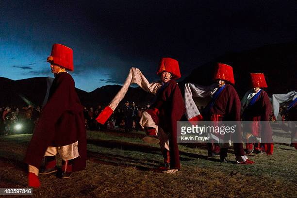 Ethnic Tibetans take part in a traditional fire dance at a local festival on July 27 2015 on the Tibetan Plateau in Yushu County Qinghai China...