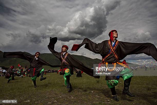 Ethnic Tibetans wearing traditional costume dance on July 25 2015 at a local government sponsored festival on the Tibetan Plateau in Yushu County...