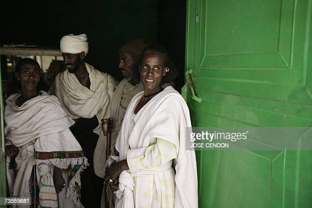 Ethnic Tigray villagers stand outside an Ethiopian jewelry store 13 March 2007 in the northern Ethiopian city of Mekele AFP PHOTO/JOSE CENDON