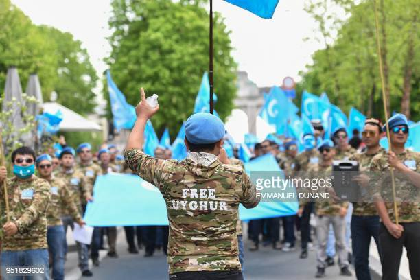 Ethnic Uighurs take part in a protest march asking for the European Union to call upon China to respect human rights in the Chinese Xinjiang region...