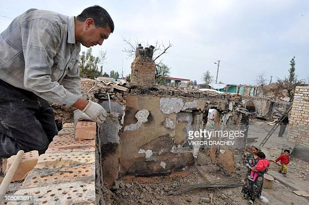 Ethnic Uzbek reconstructs his destroyed house in a village of Shark outside Osh on October 7, 2010. Kyrgyzstan is on high alert to avoid any upsurge...