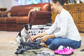 ethnic woman her 20s folds laundry